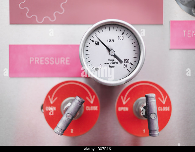Gauges and valves at gas storage plant - Stock Image
