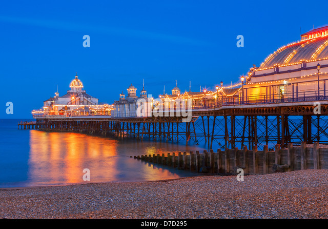 Eastbourne pier illuminated at Twilight - Stock Image