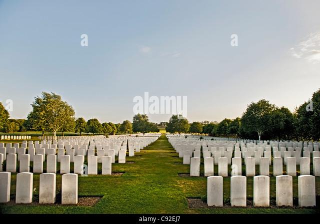White headstones in graveyard - Stock Image