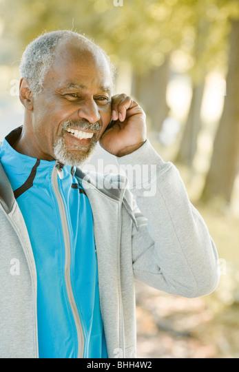 Senior man using a mobile phone, Sweden. - Stock Image