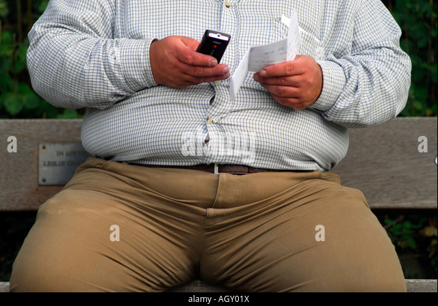 obese-man-sending-a-text-message-from-mo