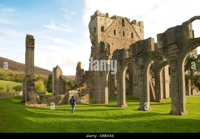 female-tourist-in-the-ruins-of-llanthony