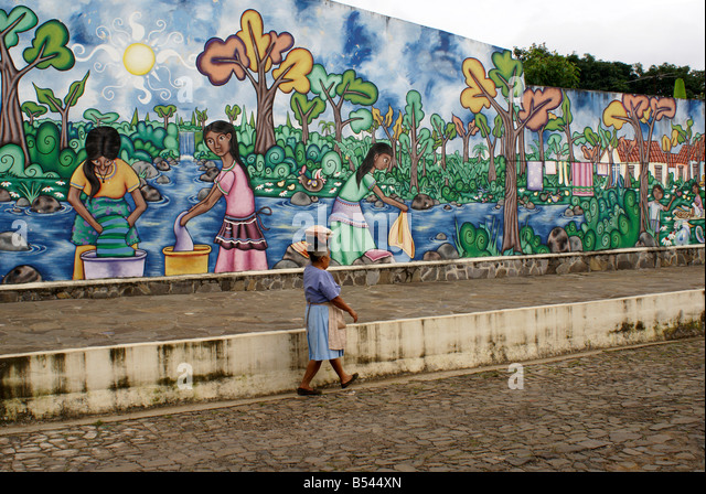 woman-walking-past-a-colorful-street-pai