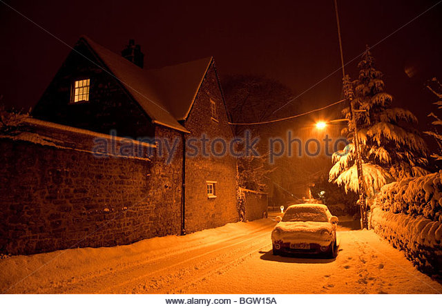 snow-scene-at-night-in-a-village-street-