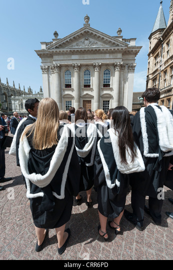 Students outside the Senate House at Cambridge University waiting to enter their graduation ceremony - Stock Image
