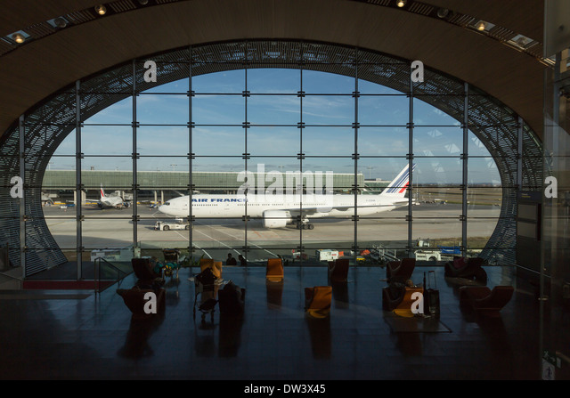 Air France Boeing 777 300 ER, taxiing in front of Terminal 2E, France. Terminal, designed by Paul Andreu, - Stock Image