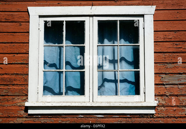 weathered-window-of-an-old-house-with-pe