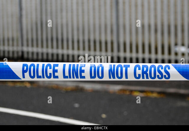 police-tape-stretched-across-a-road-at-a