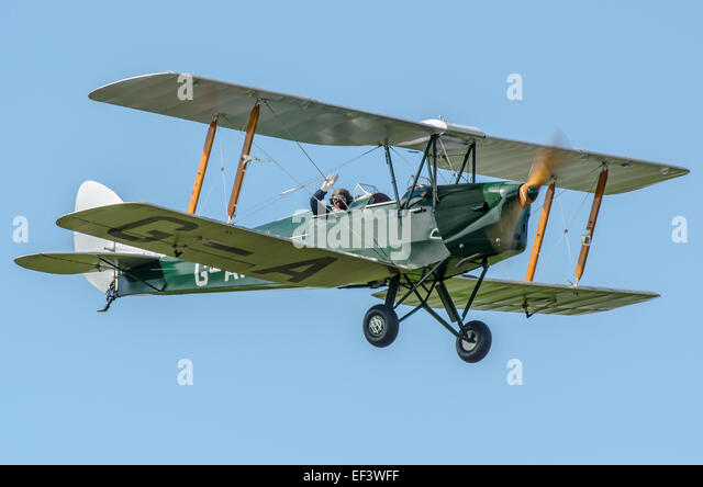 Jeff Milsom, former RAF pilot, in Tiger Moth G-AHOO. Jeff is leader of the Tiger 9 display team - Stock Image