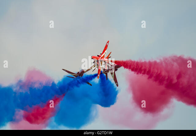 RAF aerobatic display team the Red Arrows performing their 'Detonator' break at an airshow in their Royal - Stock Image