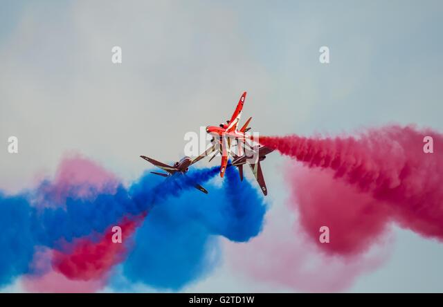 RAF aerobatic display team the Red Arrows performing their 'Detonator' break at an airshow in their Royal - Stock Image