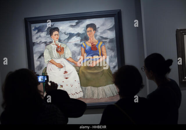 Visitors in front of the painting The Two Fridas (1939) by Mexican painter Frida Kahlo displayed at the exhibition - Stock Image