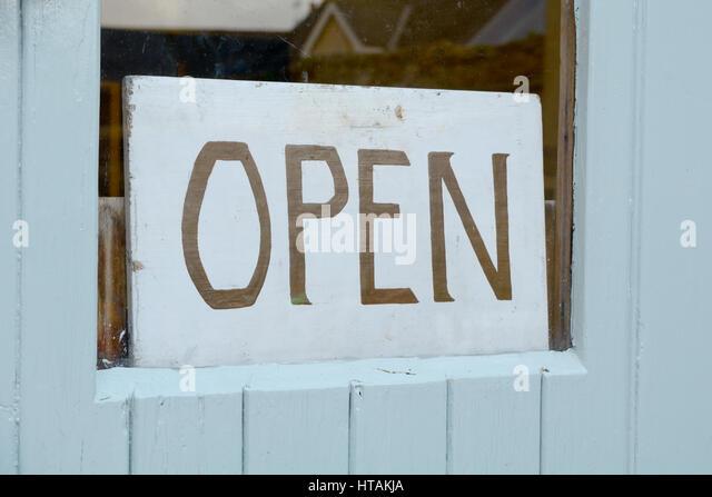 open-sign-in-window-of-business-HTAKJA.j