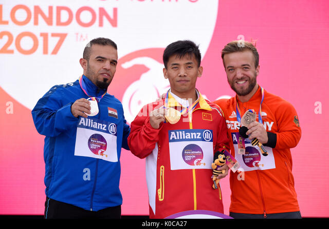 Pengxiang Sun, Wildan Nukhailawi, Mathias Mester medalists at the medal ceremony for the F41 javelin at the World - Stock Image