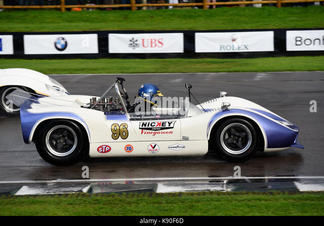 McLaren Chevrolet M1B racing at Goodwood Revival 2017 in the Whitsun Trophy. Owned and driven by Andrew Beaumont. - Stock Image