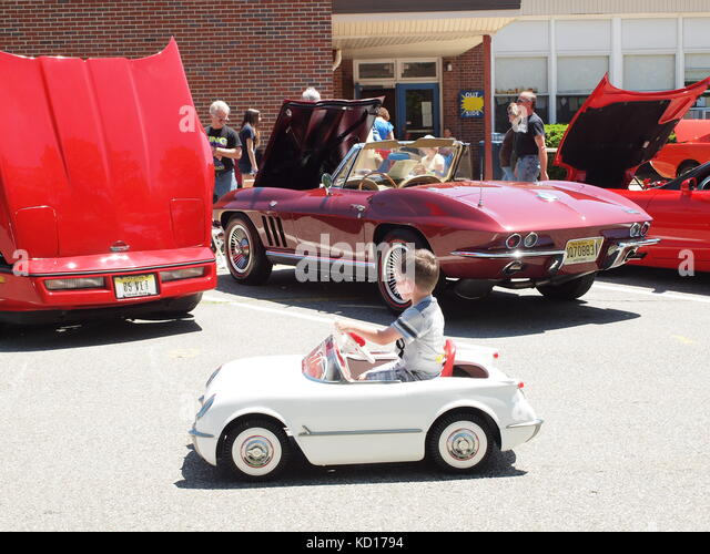 little-boy-with-corvette-pedal-car-dream
