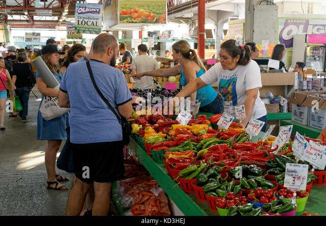 people-shopping-at-a-vegetable-vendors-s