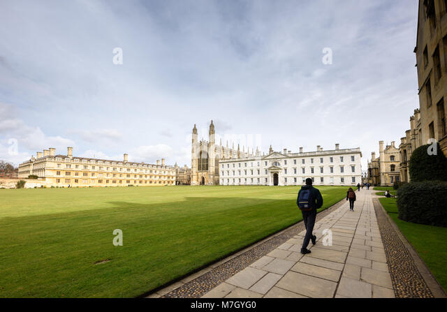 students-walk-along-a-path-alongside-the