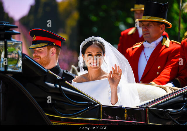 Meghan Markle and Prince Harry carriage procession after the Royal Wedding at Windsor. On the Long Walk. Duke and Duchess of Sussex. Wedding dress - Stock Image