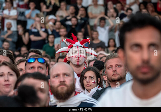 Castlefield Bowl, Manchester, UK. 11th July 2018. Football fans appear heartbroken after England lose against Croatia and are eliminated from the World Cup in Manchester during the England V Croatia semi-final match which was screened on a big screen in Castlefield Bowl. Credit: Benjamin Wareing/Alamy Live News - Stock Image