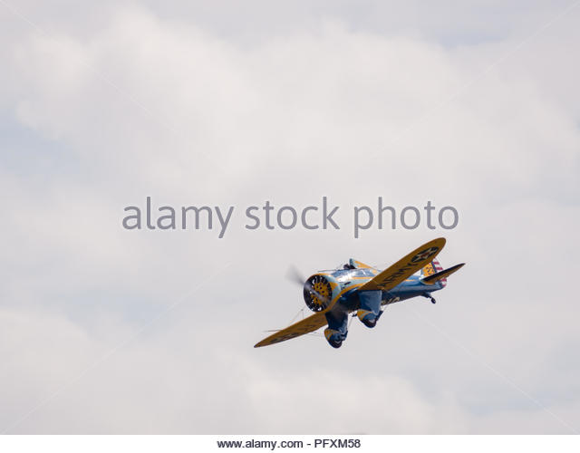 Old world war 2 plane on flyby at Duxford Air Show - Stock Image