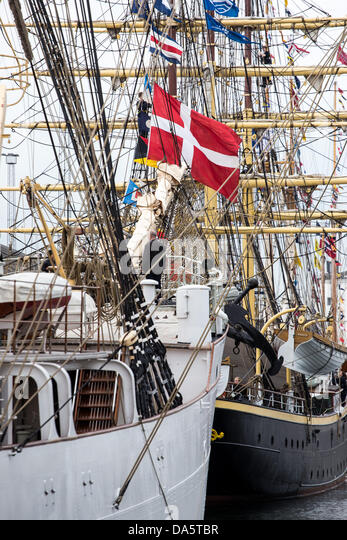 """Aarhus, Denmark. 4th July, 2013. The Danish flag at """"Georg Stage"""" during The Tall Ships Races 2013 in - Stock Image"""