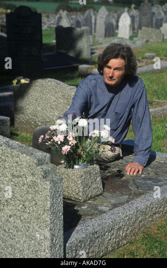 man in a graveyard - Stock Image