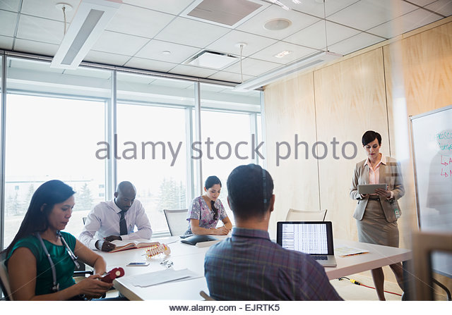 Administrator leading meeting in hospital conference room - Stock Image