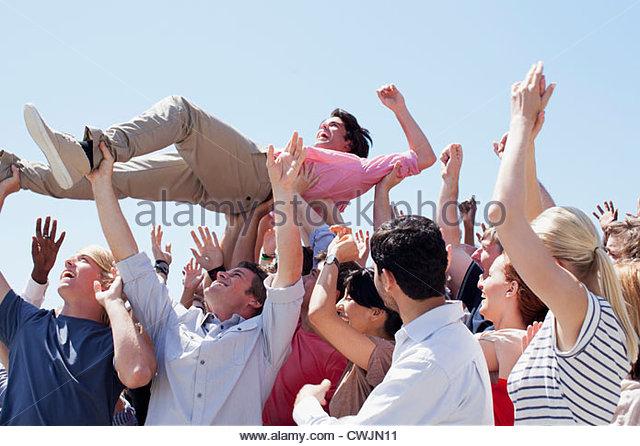 Man crowd surfing - Stock Image