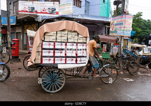 cycle-rickshaw-driver-with-full-of-load-