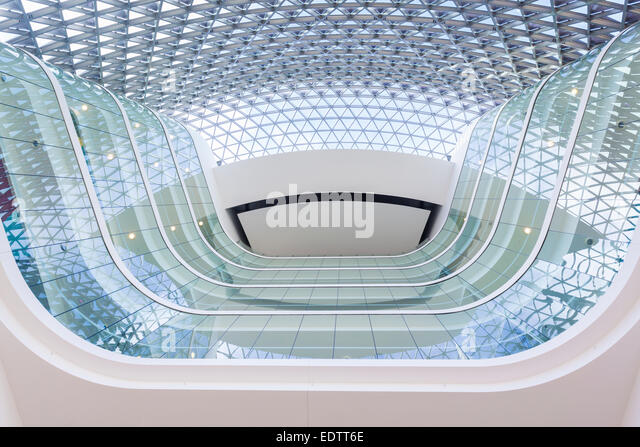 Looking up from the lobby of a modern building - Stock Image
