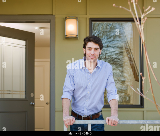 man on front porch - Stock Image