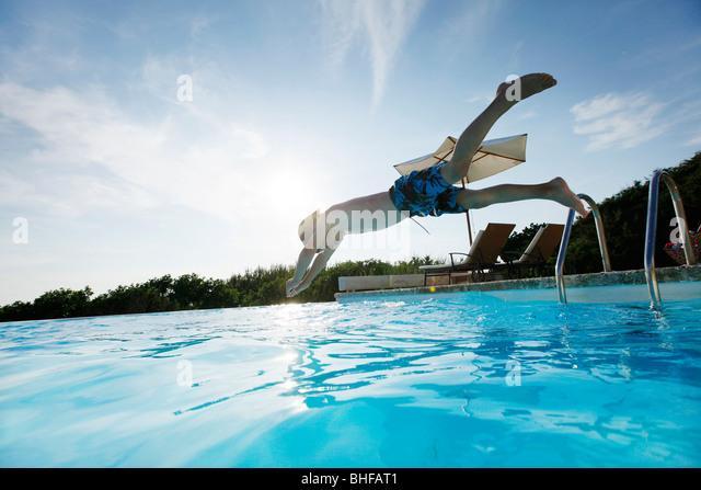 Boy diving into the pool, pool, Las Dunas Playa, Formentera, Balearic Islands, Spain - Stock Image
