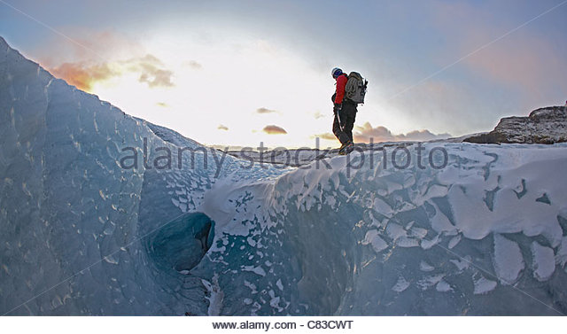 Man walking on glacier - Stock Image