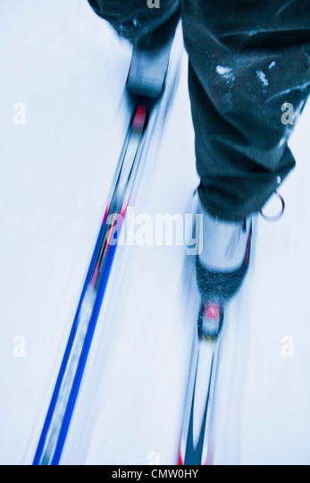 Low section of a person cross-country skiing - Stock Image