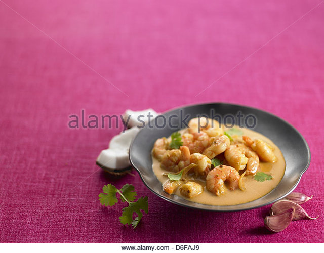 prawn soup with coconut and garlic - Stock Image