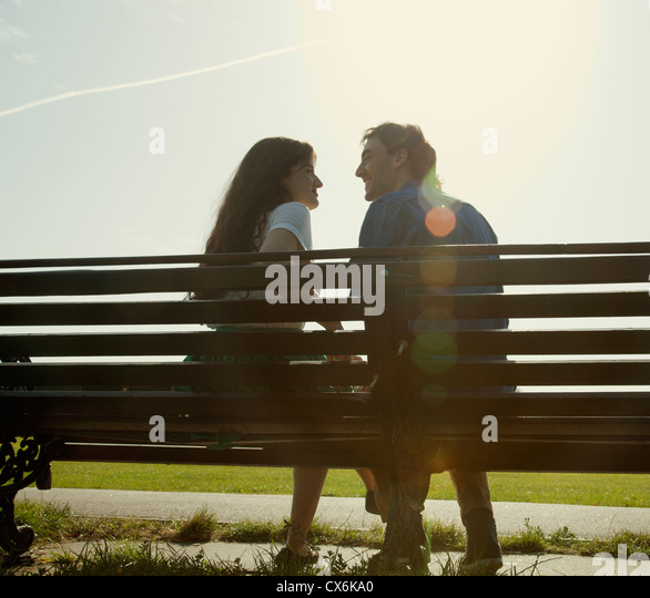 Intimate Couple on Bench - Stock Image