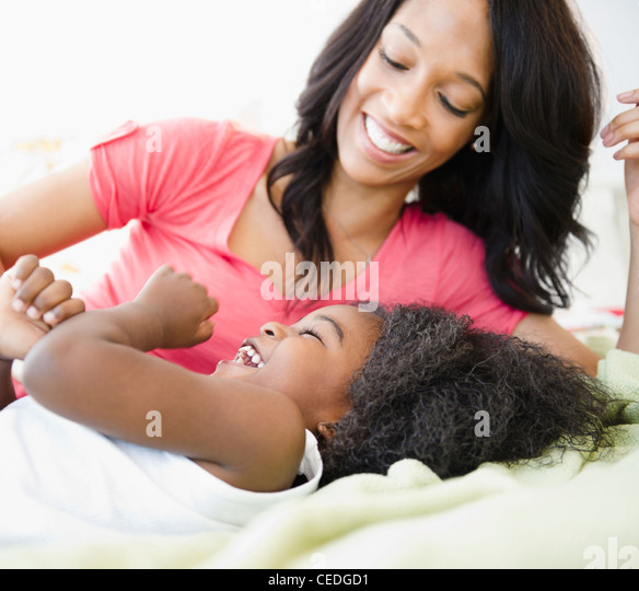 African American mother playing with son - Stock Image