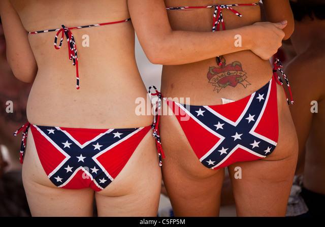 Young women wearing confederate bikini's at the annual Summer Redneck Games Dublin, GA. - Stock Image