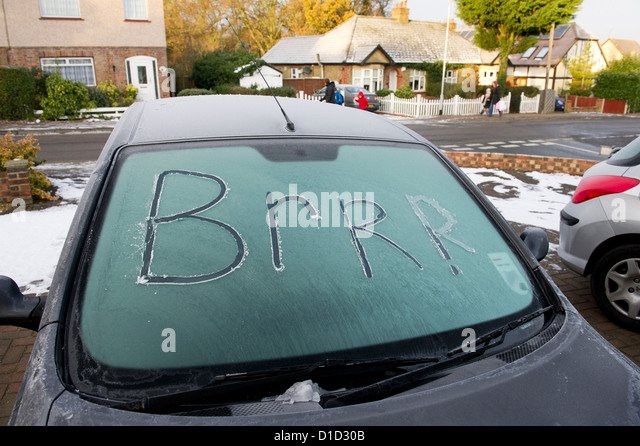 words-scraped-into-the-ice-on-a-car-wind