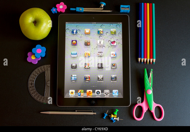Ipad 3 with school accesories on white background - Stock Image