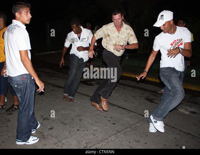 Locals dance on the street in Varadero, provincia de matanzas, cuba - Stock Image