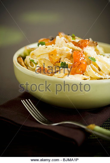 Bowl of Goast Cheese Pasta - Stock Image