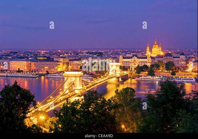 Chain Bridge, Gresham Palace, Danube River and St. Stephen's Basilica, Budapest, Hungary. View from Castle Hill - Stock Image