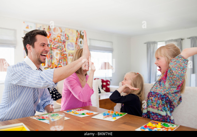 Family does the high five - Stock Image