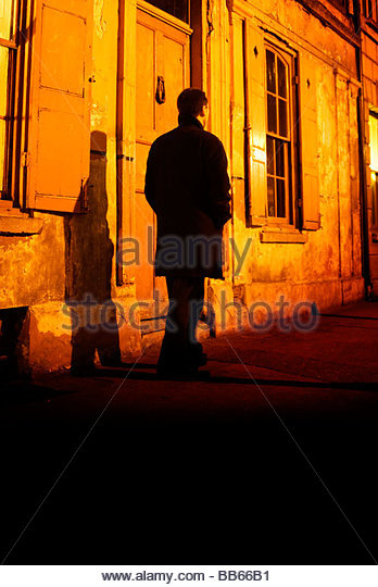 man with waiting in the shadows - Stock Image