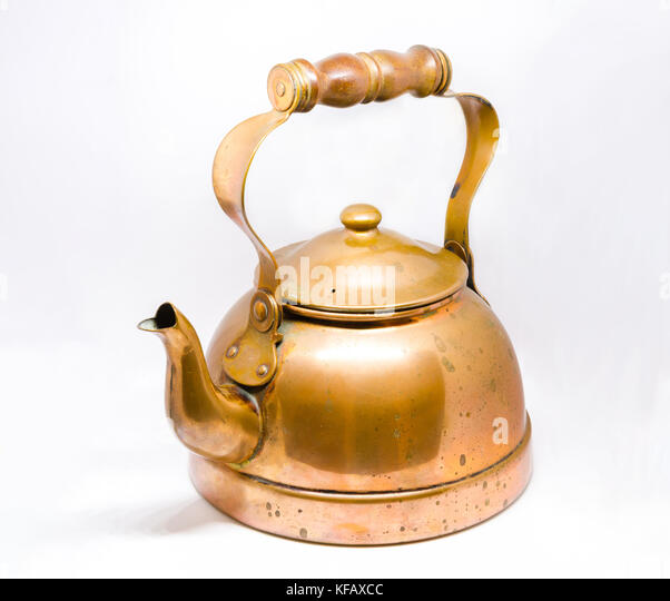 An antique brass copper kettle - Stock Image