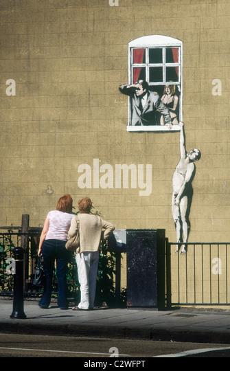 wall-painting-by-banksy-of-naked-man-han