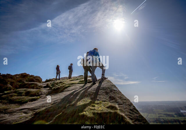 climbers-at-the-top-of-the-roaches-leek-