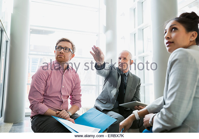Business people meeting in lobby - Stock Image